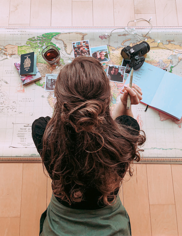Woman planning her next trip with map