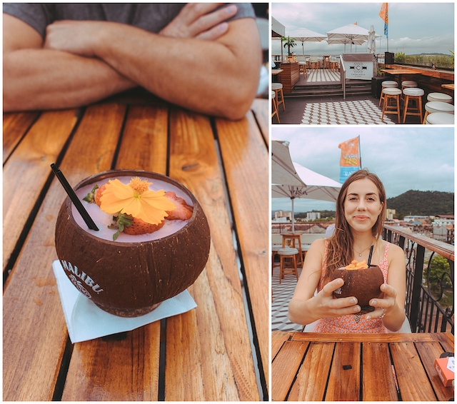 Drink in coconut cup on rooftop bar in Panama City