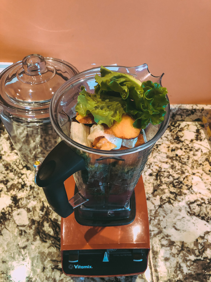 Green smoothie with fruit in Vita-Mix