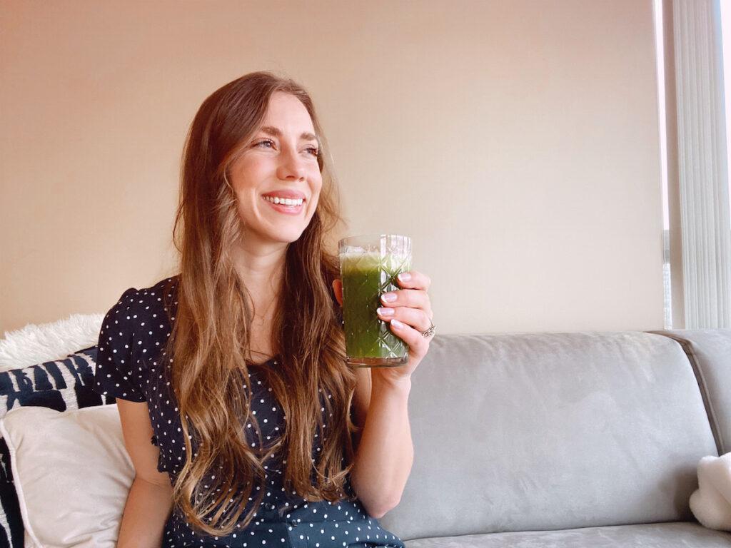 Woman drinking a green celery juice