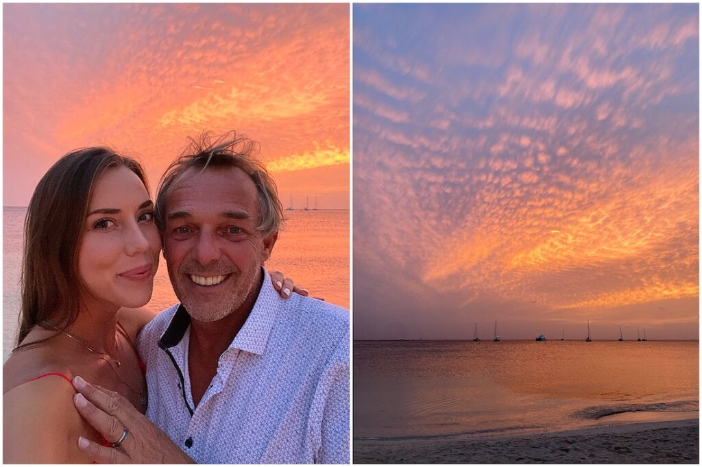 an age gap couple on the beach watching a sunset